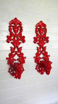 These red candle stick holders look great against this brick wall.