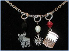 """""""Sam"""" Necklace: item: Laptop Charm- Protection Tattoo Charm-Moose Charm-Red bead to symbolize blood-White bead to symbolize salt-Black bead to symbolize demons"""