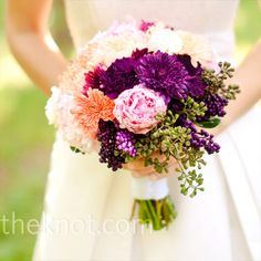 Purple and Pink Bouquet- A cluster of football and button mums, peonies, daisies and herbs had a just-picked look.