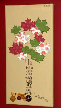 Canvas painted with stitched on leaves and buttons. Favorite verse written as a tree.