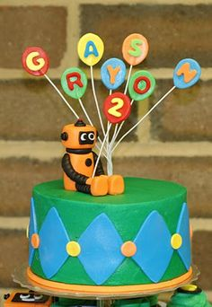 robot cake - maybe a toy with dum dum balloons?