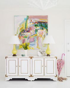 Fun, colorful foyer design with white vintage cabinet