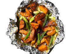 Scallion Sweet Potatoes:  Combine 1 1/2 pounds chopped peeled sweet potatoes, 1 bunch scallions (cut into 2-inch pieces), 6 crushed garlic cloves and 1 tablespoon fresh thyme in a bowl. Drizzle with 1/4 cup olive oil, season with salt and pepper and toss. Place on a sheet of foil and fold up. Grill over low heat until the potatoes are tender, 20 to 25 minutes. (oven 425 for 30 mins.)