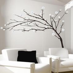 tree with white flowers I like this a lot.  I would add small lights for beautiful ambiance light.