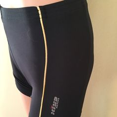 Hind black cycling spin shorts NWOT spin shorts. Perfect for a short ride or spin class. Black with golden stripe. Hind Shorts