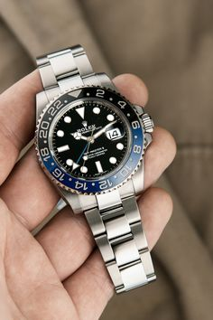 """The Rolex GMT-Master II Ref. 116710BLNR, called """"Batman"""", is not only casual enough to go with your everyday look during the day, but also robust enough to shine in an actual case of emergency with the qualities of a real toolwatch: water-resistant up to 100 meters, a date window at 3 o'clock, the possibility to display up to 3 time zones at the same time, a two-coloured bezel to distinguish between day and night time as well as a case and bracelet made of the robust stainless steel alloy… Stainless Steel Alloy, Rolex Models, Rolex Gmt Master, Luxury Watch Brands, Time Zones, 3 O Clock, Distinguish Between, Everyday Look, Bracelet Making"""