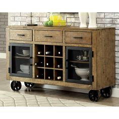 This eye-catching industrial-inspired server features multiple storage compartments to hold your dining essentials. The three drawers, nine wine slots and dual cabinets each offer a home for silver, special occasion drinks and other servingware.