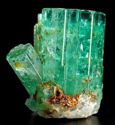 Emerald; the green variety of the mineral beryl. framework silicate, although sometimes argued as a ring silicate. shown here in a hexagonal prism.