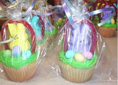 Easter basket cupcakes made with Peeps, twizlers and malted balls. Put in sandwich bag and tie with curly ribbon. Easter craft. Fundraising idea