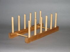 """Dish and Lid Rack by Woodform. $13.95. Dowels are nailed into place for lasting durability. Size: 12""""L x 5-1/2""""W x 4-5/8""""H. 5 spaces 1-1/2"""" wide hold plates or lids in an organized manner. Hand crafted in the USA from select northern hardwoods. Has a beautiful lacquer finish. Organize your lids or dishes in an organized file fashion for easy access.  Attractive enough for use on the counter or use inside your cupboard.  Made in the USA from northern hardwoods and n..."""