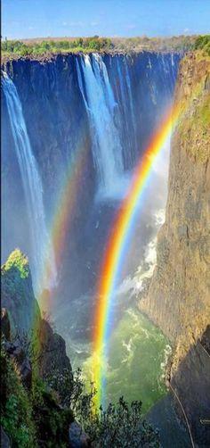 Waterfall - Plummeting Rainbows at Victoria Falls, Matabeleland North, Zimbabwe, Africa.- by wbirt1