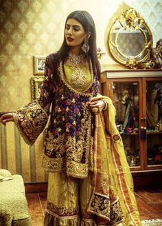 This royal blue angrakha shirt is embellished with resham thread. It comes with embellished gharara and beautifully coordinated with yellow duptta. Shadi Dresses, Pakistani Formal Dresses, Pakistani Wedding Outfits, Pakistani Wedding Dresses, Pakistani Dress Design, Bridal Outfits, Indian Dresses, Pakistani Mehndi Dress, Indian Designer Outfits