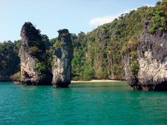 Exploring Phang Nga Bay and taking in the sights of the limestone monoliths. Discover the beautiful scenery by a local longtail boat!