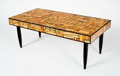 Allen Kinast, talented designer and artist, works with reclaimed wood to create authentic and unique furniture pieces! See the mosaic tables below!