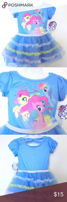 My Little Pony Blue Triple Tulle Tiered Skt 2T New OHHHhhhhhhhhhh just to cute little dress Girls Size 2T By Hasbro New With Tags  Rounded neckline and short puffy sleeves My Little Pony on bodice is hi lighted with silver It says SHINE ON! Also in silver Band in silver that covers the seam at the waist Three tiers of tulle in white, yellow and light pink against the blue tulle skirt Two skirts of gathered tulle underneath with blue lining under that Fabric that criss crosses in back of neck…