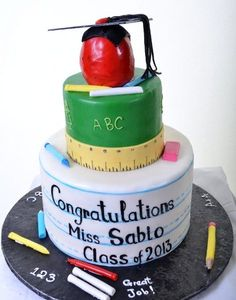 Teacher's Cake. There's no denying that this is a Teacher's cake, through and through. Two round tiers and decorated in immediately recognizable fashion - the bottom of white with the solid and dotted lines we all remember from our 'learning how to write' days (and we learned, you can tell - because the salutations are perfectly aligned!); and the top round of green fondant, trimmed with a yellow ruler and adorned with an apple for the teacher on top.