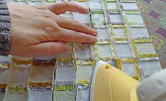 """Tutorial on quickly assembling those tiny squares into perfect blocks--this is genius, I would never have touched a 2"""" square without seeing this, but they come out guaranteed to have all the corners match and are super quick. love this."""