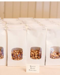 This couple drenched popcorn in rocky road and herb Parmesan flavoring for guests to snack on post-ceremony.