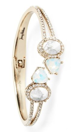 Swooning over this hinge bracelet that is decorated in jewels and glistening crystals.