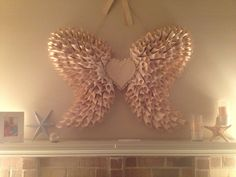 Angel wings made from pages from a book by yours truly. Cheap, easy, painstakingly time consuming.
