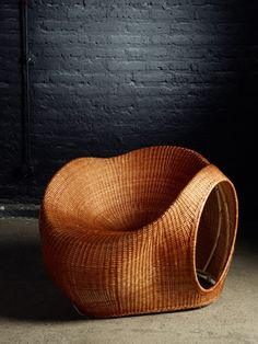 Handmade mimbre chair.  Amalia by Eggpicnic, celebrates a Chilean material called mimbre, going back to the essential of working with traditional materials and techniques. The technique of hand weaving mimbre originated in Chimbarongo, a town located 160 km south of the Chilean capital. This project was conducted in conjunction with mimbre artisans Francisco Palma and Mario Rojas.