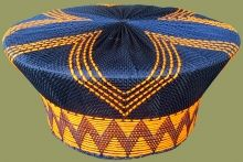 Zulu Hats are traditionally worn by the married Zulu woman of South Africa with brighly colored African designs. Zulu hats are called Isicholos in Zulu. Zulu Traditional Wedding, African Fashion Traditional, African Hats, African Attire, African Clothes, African Dress, South African Tribes, Zulu Wedding, Zulu Women