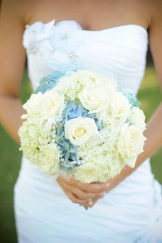 Beautiful vintage-style antique blue and white bouquet.. hydrangeas, roses and accents of pearls and feathers. #vintage #bouquet