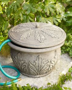 Acanthus Leaf Hose Holder - Horchow probably not very practical but it sure looks nice!