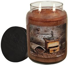Our Vanilla Hazelnut Jar Candle shows off a vintage Irvin Hoover design of an antique coffee grinder with coffee beans in a rustic setting.