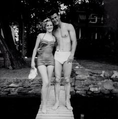 1950s vintage black and white photo of a teenage bathing beauty in a maillot bathing suit and hunky guy in white swim trunks. taken at Orange Lake in Upstate New York.
