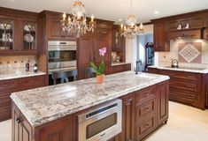 This Central Ohio kitchen is filled with dark cherry wood cabinets and beautiful granite countertops.