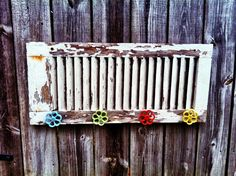 Old wood shutter repurposed into wall hook with water spout knobs