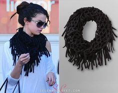Before Selena Gomez stunned at the red carpet at the Golden Globes afterparty, she got 'papped' leaving a CVS earlier that day wearing this Dream Out Loud Lattice Infinity Scarf in black. Its finally available on kmart.com and you can get it for $11.99.   Buy it HERE  She wore this scarf with 291 pants, Vince Camuto boots, and her Dolce & Gabanna bag. We are looking for her top.