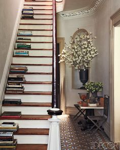The look is amazing.  I love the pattern on the stairs that makes it look like a keyboard.  Somebody really creative came up with that.  Dusting and cleaning would be a huge bother though.  This would make a good temporary art installation, then pick the books up and keep them safe in the bookcase.