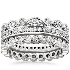 love the top one for a second band eventually.... Platinum Luxe Antique Eternity Diamond Ring Stack (1 ct. tw.)