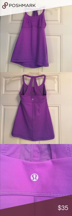 Lululemon purple tank size 6 Women's Lululemon tank top. Beautiful light purple color. Size 6. Has only been worn 4 times - like new. Has built in bra and space for inserts (not included). Flattering halter style with back straps. lululemon athletica Tops Tank Tops