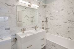 The spa-like bathroom is huge and comes complete with a soaking tub.  #refinery29 http://www.refinery29.com/2016/04/108928/alexis-bledel-vincent-kartheiser-brooklyn-heights-penthouse-apartment#slide-8