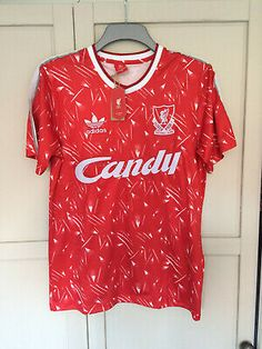 This LFC Candy GK Shirt is a replica of the green Goalkeeper Shirt famously worn by Bruce Grobbelaar. To the left of the chest is a raised retro Liverbird crest badge and to the centre of the chest is raised Candy in white. Classic Football Shirts, Vintage Football Shirts, Retro Shirts, Liverpool Kit, Liverpool Football Club, Goalkeeper Shirts, British Football, Adidas Football, Football Kits