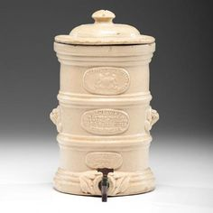 A stoneware cooler with removable plate filter and metal spout, having a banded body with lio Water Coolers, Stoneware, Auction, Water Filters, English, Ceramics, Band, Metal, Jars