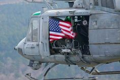American troops, aboard helicopter, display US flag as they defend our freedom. Thank you to all in the military who sacrifice so much for us. I Love America, God Bless America, American Pride, American Flag, American Soldiers, Independance Day, My Champion, Thanks, Flag