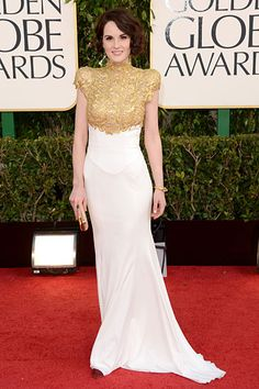 Michelle Dockery is statement-making in bold-shouldered cream and gold gown by Alexandre Vauthier.