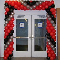 Prefer a linear look? With careful framing, clean, crisp entrance décor can perfectly frame a doorway. And, no helium required.