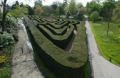 HAMPTON COURT PALACE, Surrey, England: The maze at Hampton Court Palace was created in 1702. It's Britain's oldest hedge maze with winding paths amounting to nearly half a mile and covering a third of an acre.