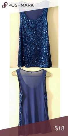 Sequin Scoop Neckline Top Easily paired with your favorite pair of pants or skirt. This royal blue sequin tank top will fit seamlessly into your wardrobe. Perfect condition worn once.  Scoop neckline  Sleeveless Straight silhouette with an easy fit 100% Rayon Charlotte Russe Tops Blouses