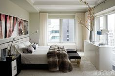 The custom-made headboard in the master bedroom is upholstered in an alpaca velvet, and the task lamps are reproductions of an Édouard-Wilfred Buquet design; Kelly Behun designed the side tables of ebonized wood and shagreen and the lacquer console, the stools are 1940s French, and the prints are by Mariah Robertson. For the full tour of Ivanka's Manhattan apartment, click here.   - ELLEDecor.com