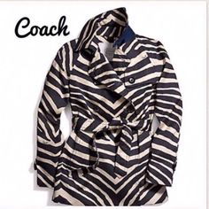Coach ladies zebra trench coat Navy and ivory zebra trench coat size S (4-6). Has removable belt. Inside material is ivory with the original Coach logo. Purchased at Coach at Tanger Outlet in Foley, AL. Never worn. Still in the zipper bag it came in and have original receipt. Coach Jackets & Coats Trench Coats