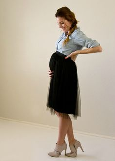 This black tulle skirt looks adorable! Plus, blogger Kayla Moncur had the idea to wear one of her pre-pregnancy button-ups, leaving it unbuttoned beneath the skirt. Genius!