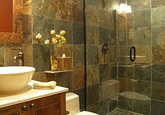 Small Bathroom Big Design. Great use of the Glass shower doors to help the room feel begger and more open!!