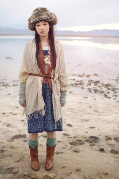 Light linen-y overcoat layered over printed dress, leggings, knee-socks, brown boots, with fingerless arm warmers