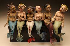 Mermaids in a row Carving
